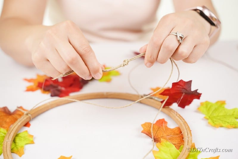 Adding fake leaves to craft hook woman hands