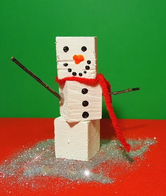 Block snowman on red table
