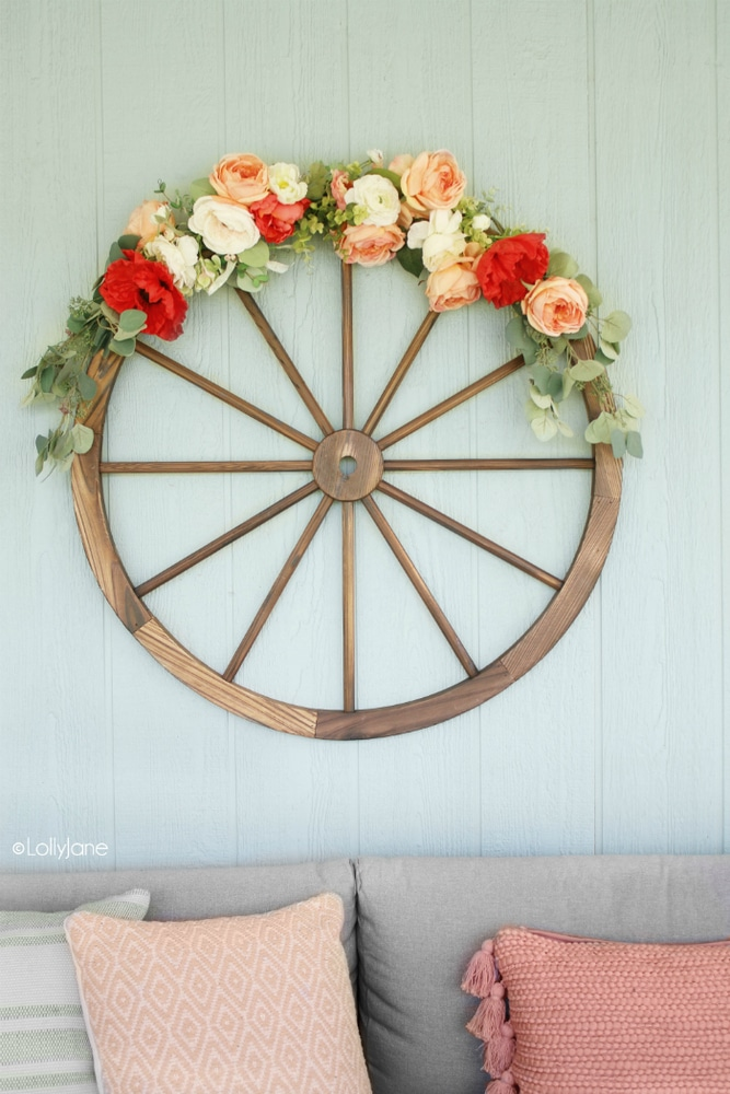 Wagon wheel wreath with flowers