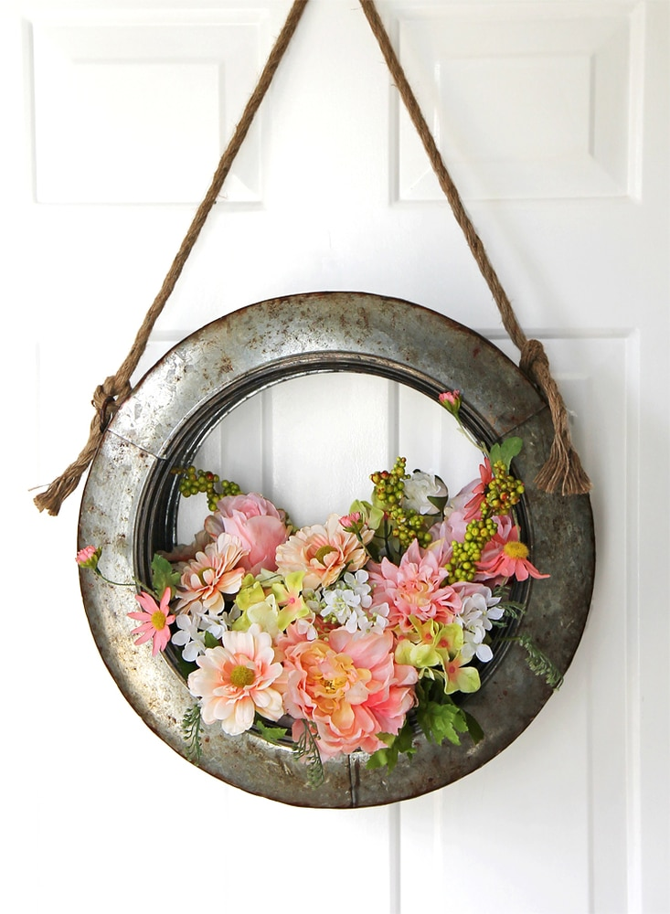Tire rim wreath with flowers