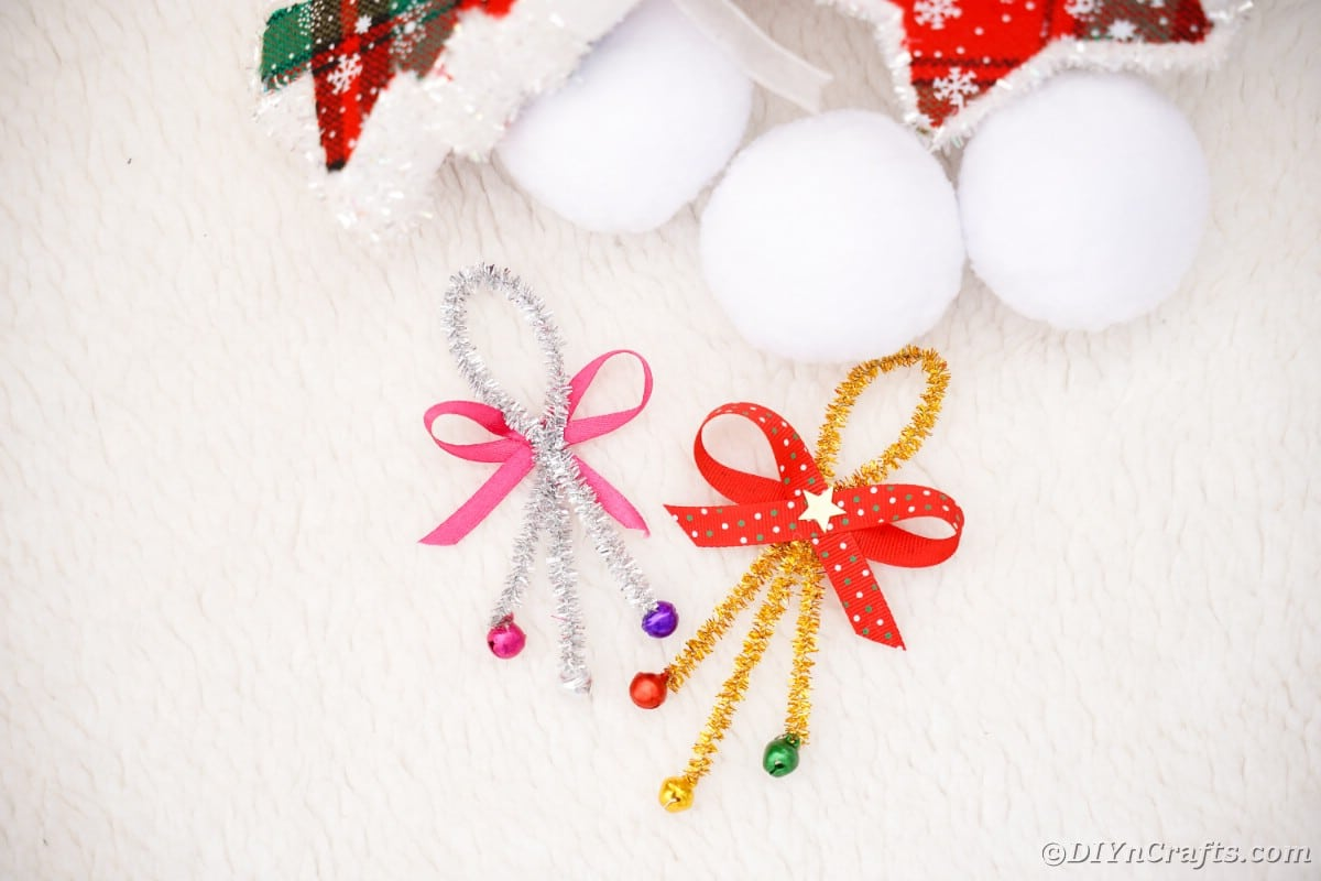 Jingle bell ornament on white table