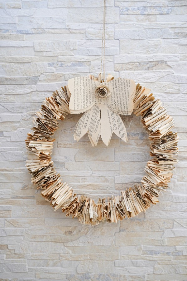 Fold book page wreath on brick wall