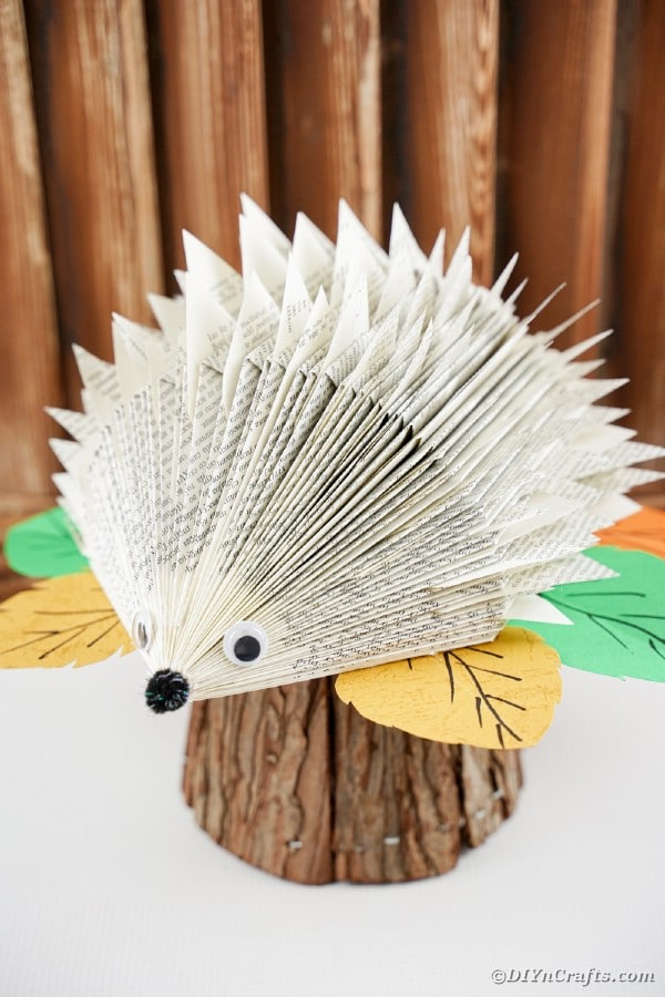 Paper hedgehog on stump