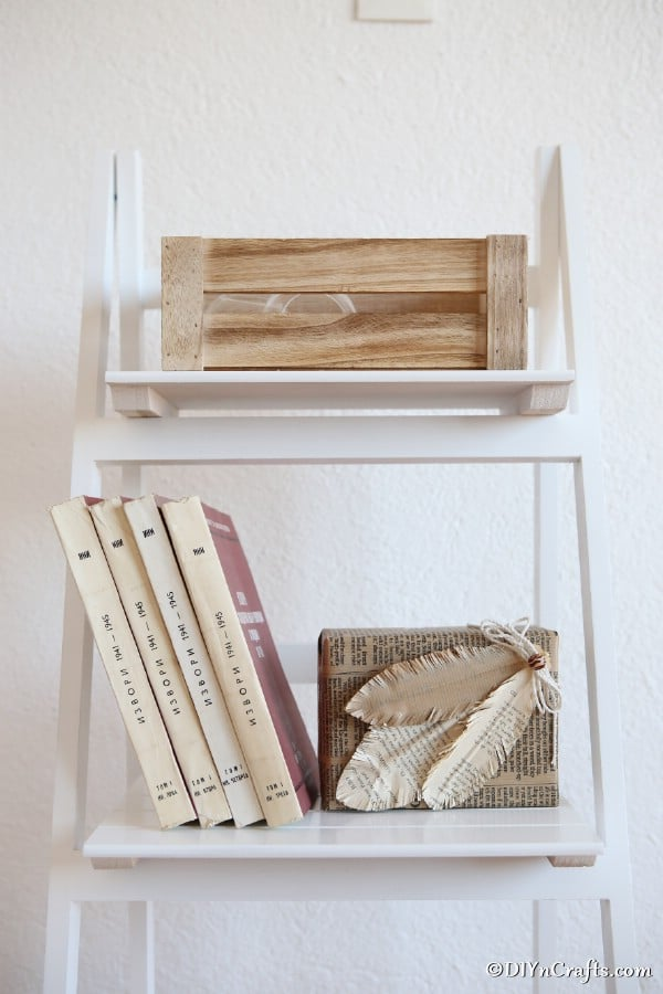 Paper feathers on book case