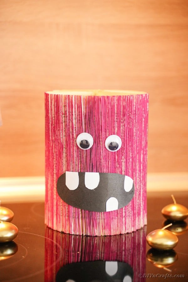 Pink old book monster