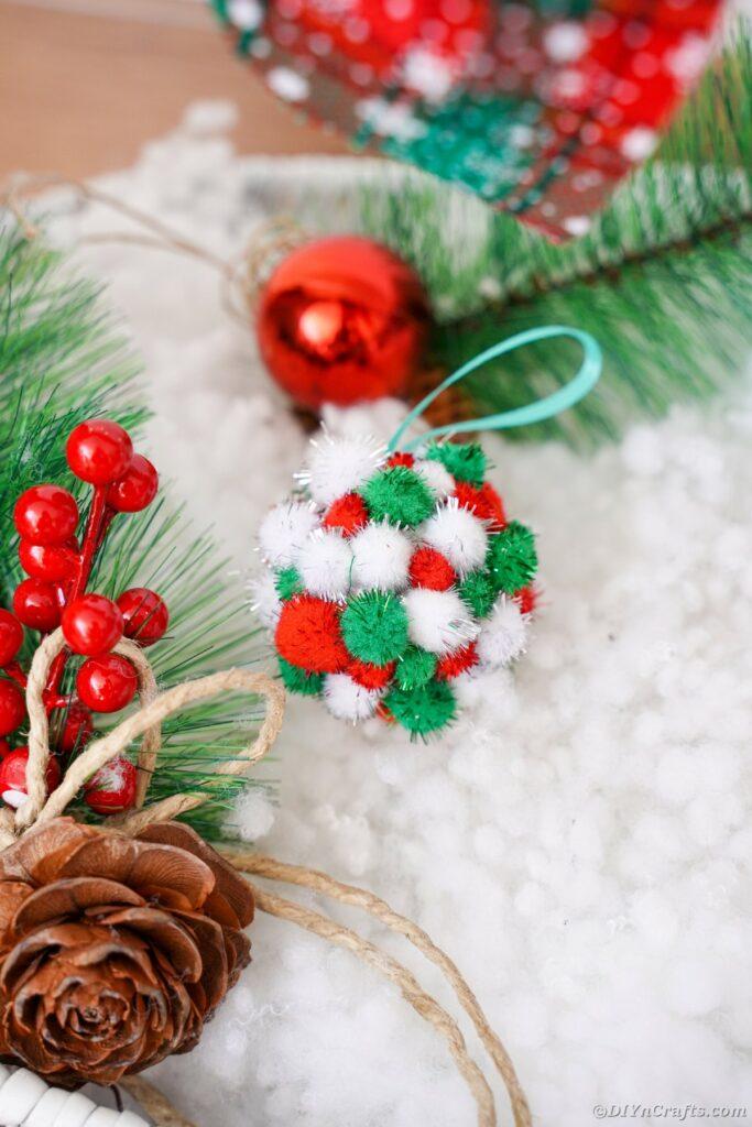 Pom Pom ornament on fake snow