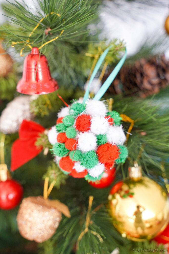 Pom pom ornament on tree