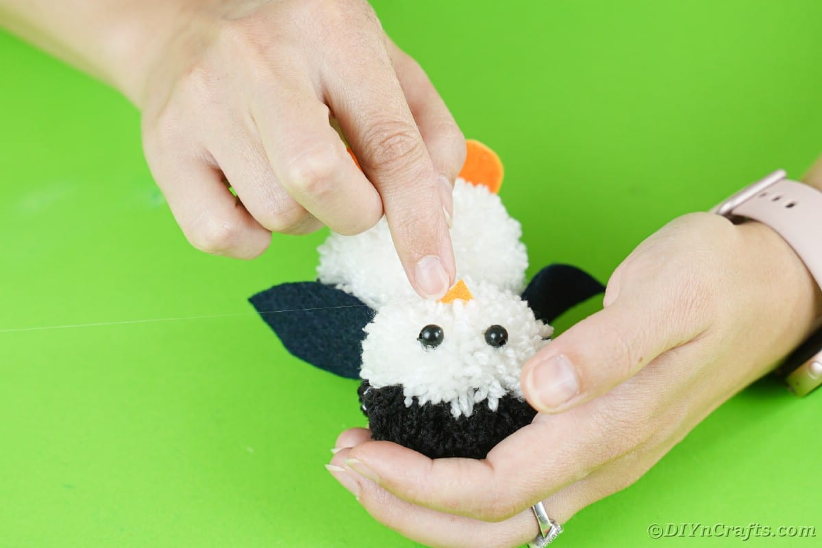 Gluing nose on penguin