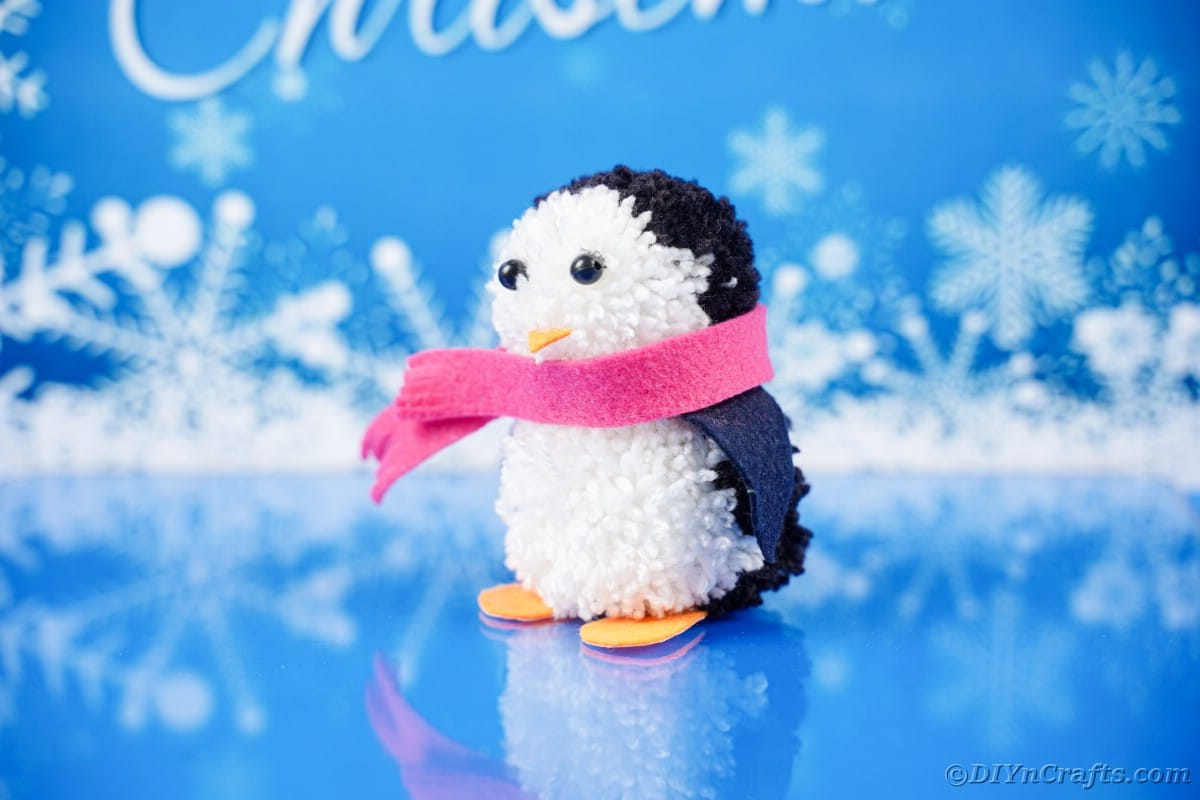 Penguin on blue holiday paper