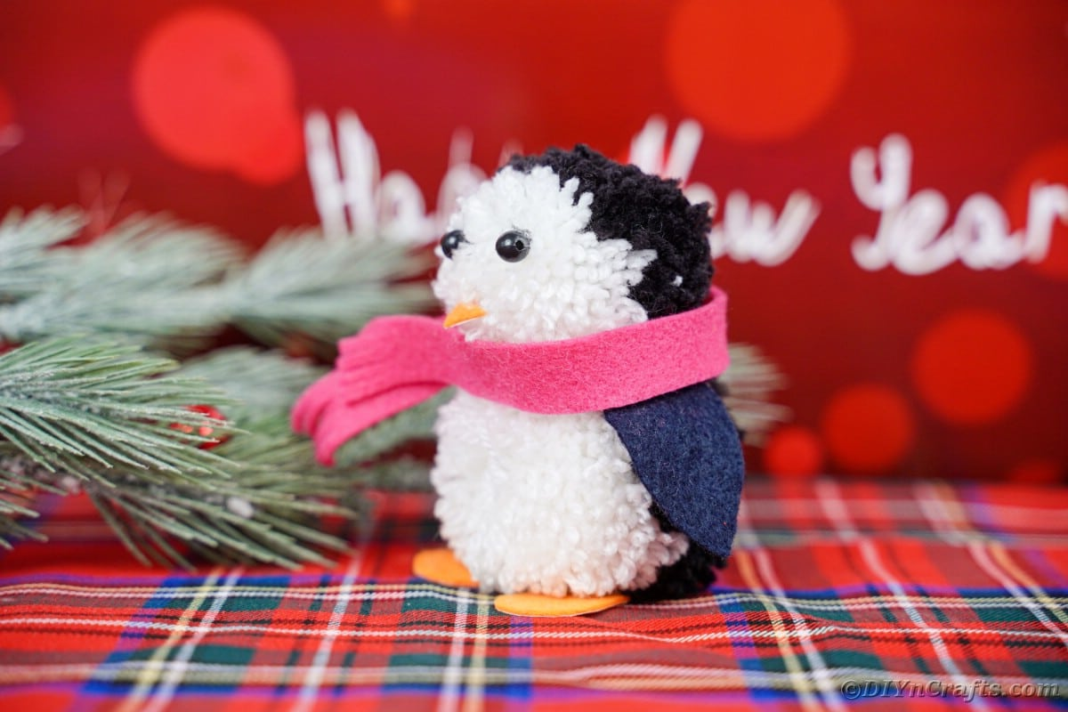 Pom pom penguin on flannel