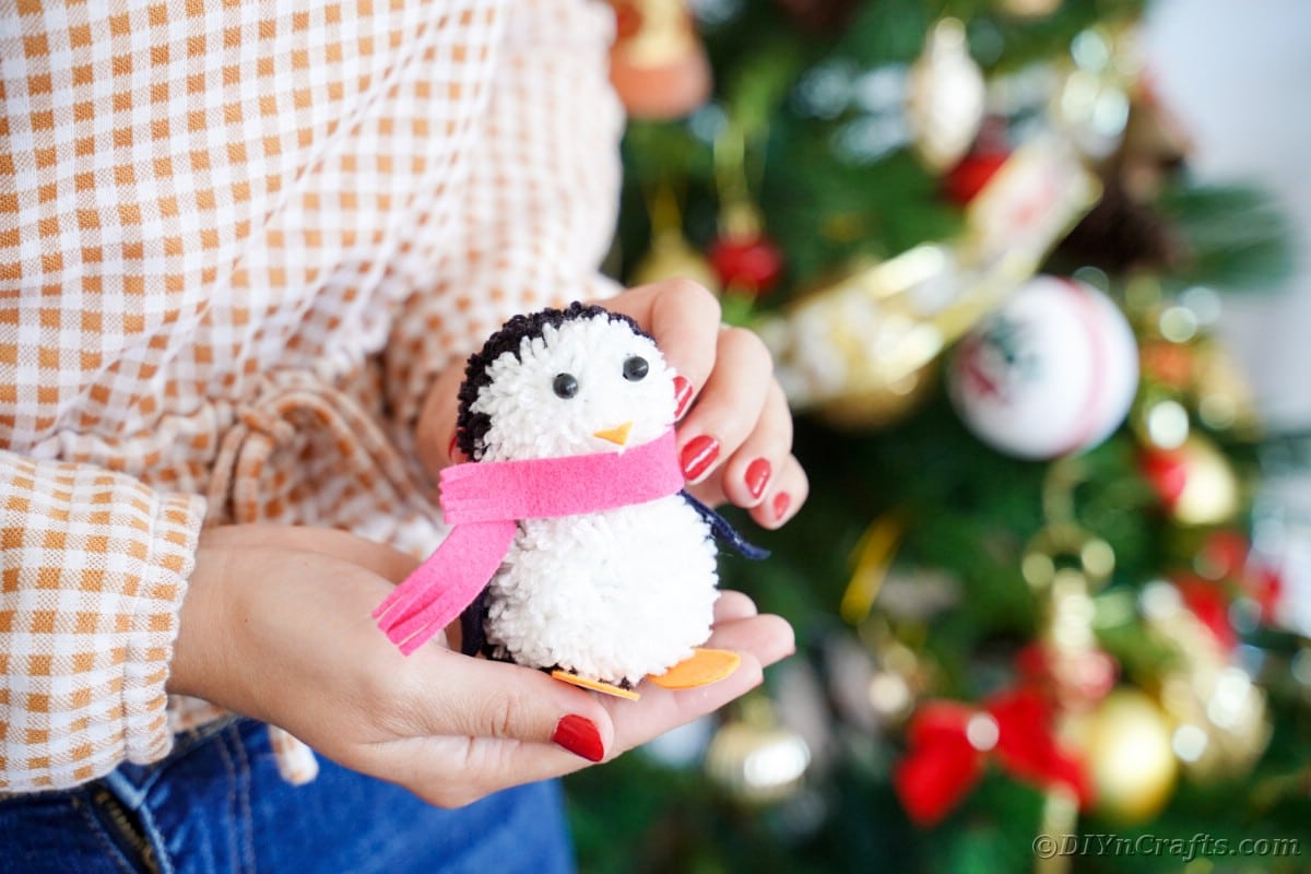 Woman holding toy penguin