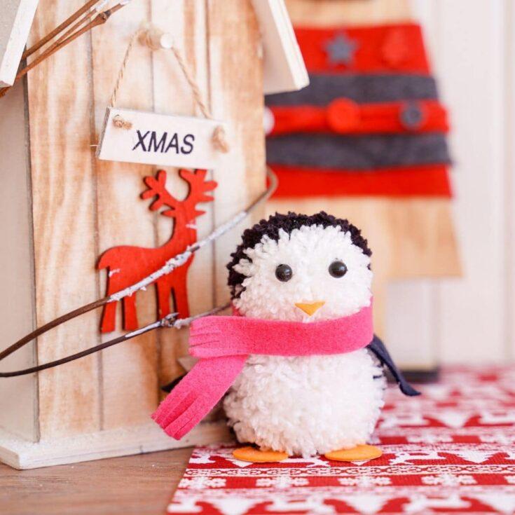 Pom pom penguin by wooden decor