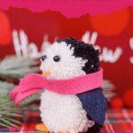 Pom pom penguin on flannel