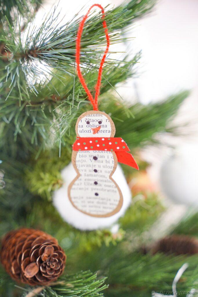 Snowman ornament in tree