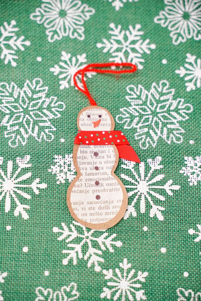 Snowman on green paper