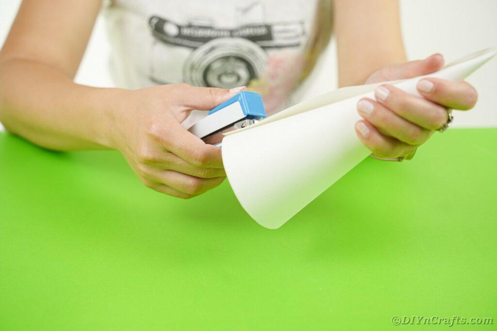 Stapling paper into cone