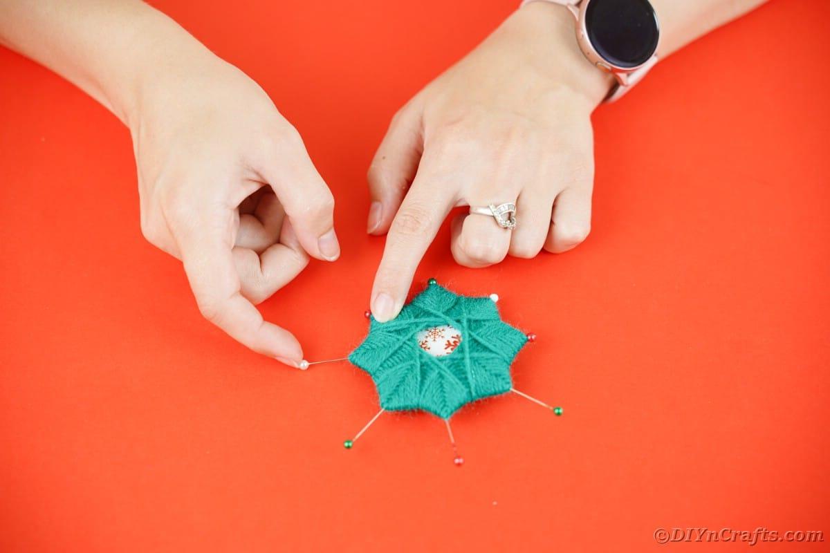 Pushing pins into star