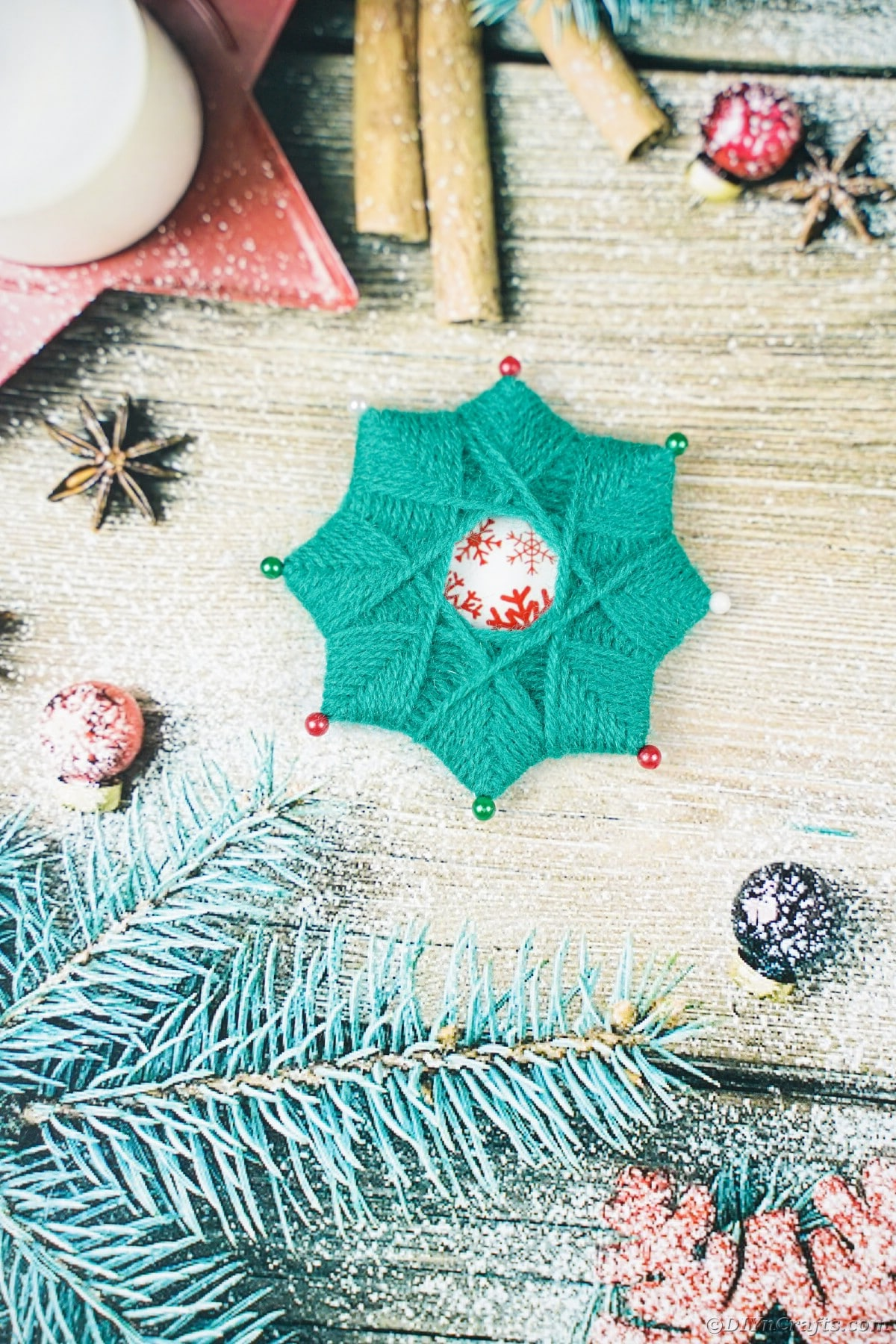 Yarn star on Christmas paper
