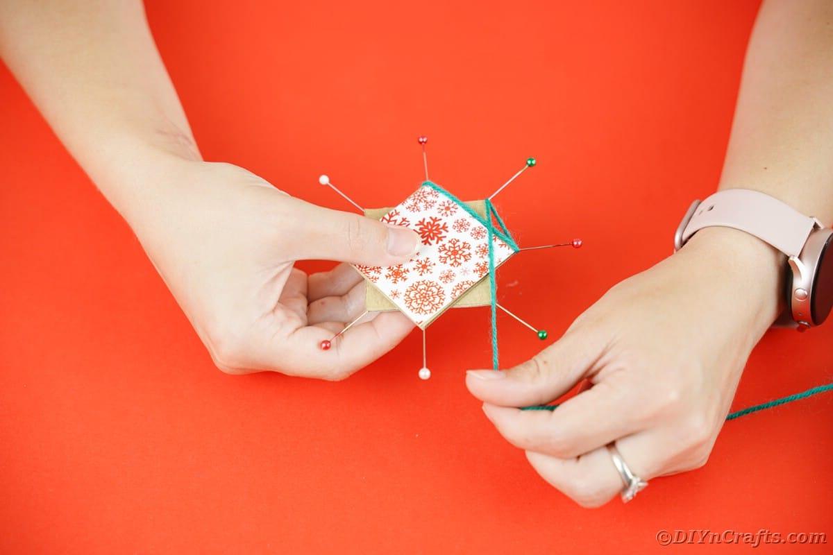Wrapping yarn around pins