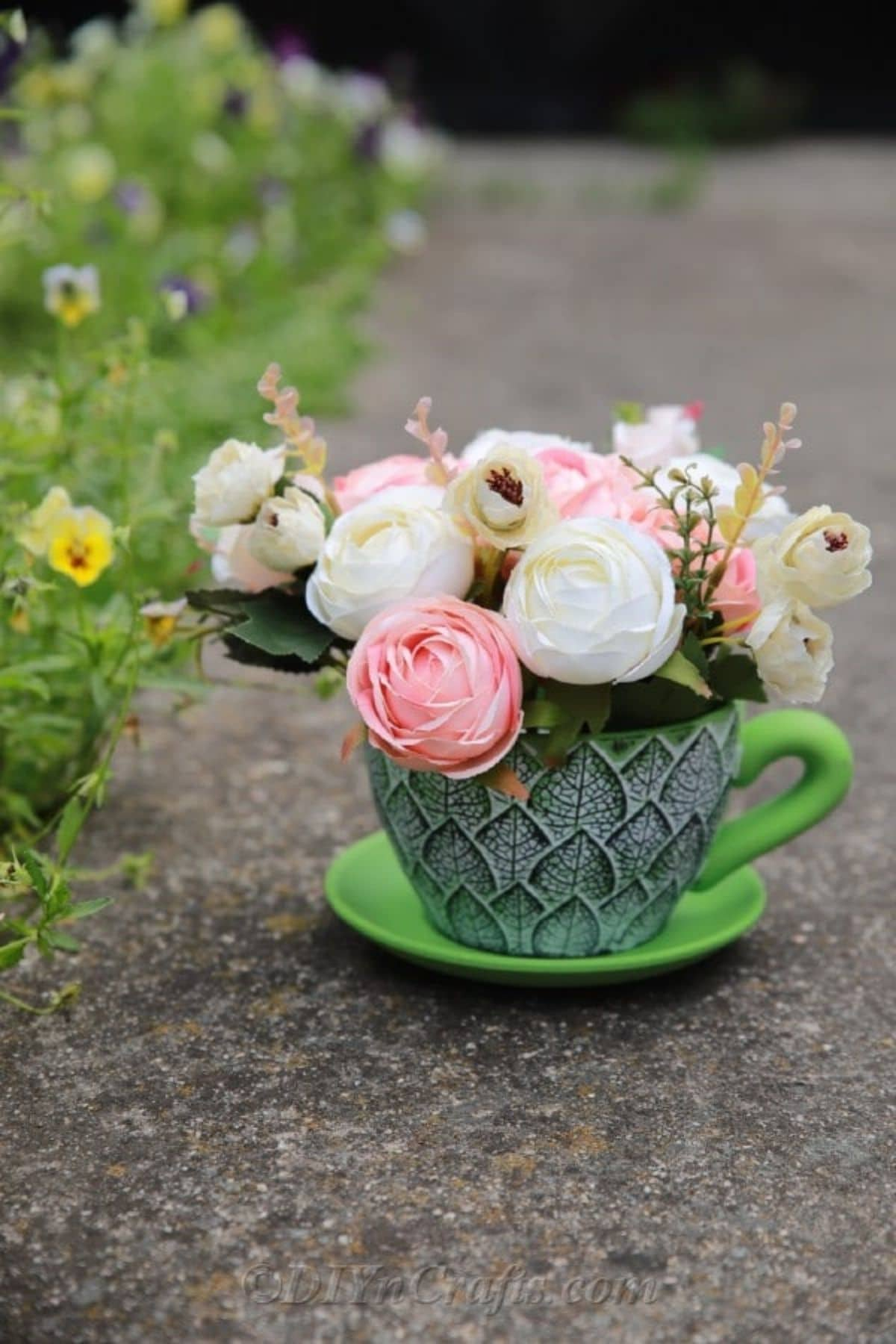Teacup filled with flowers