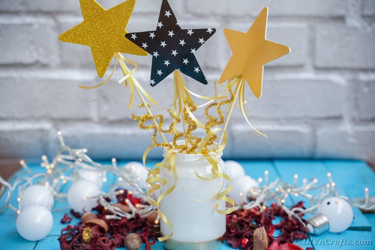 Mason jar decoration against white brick