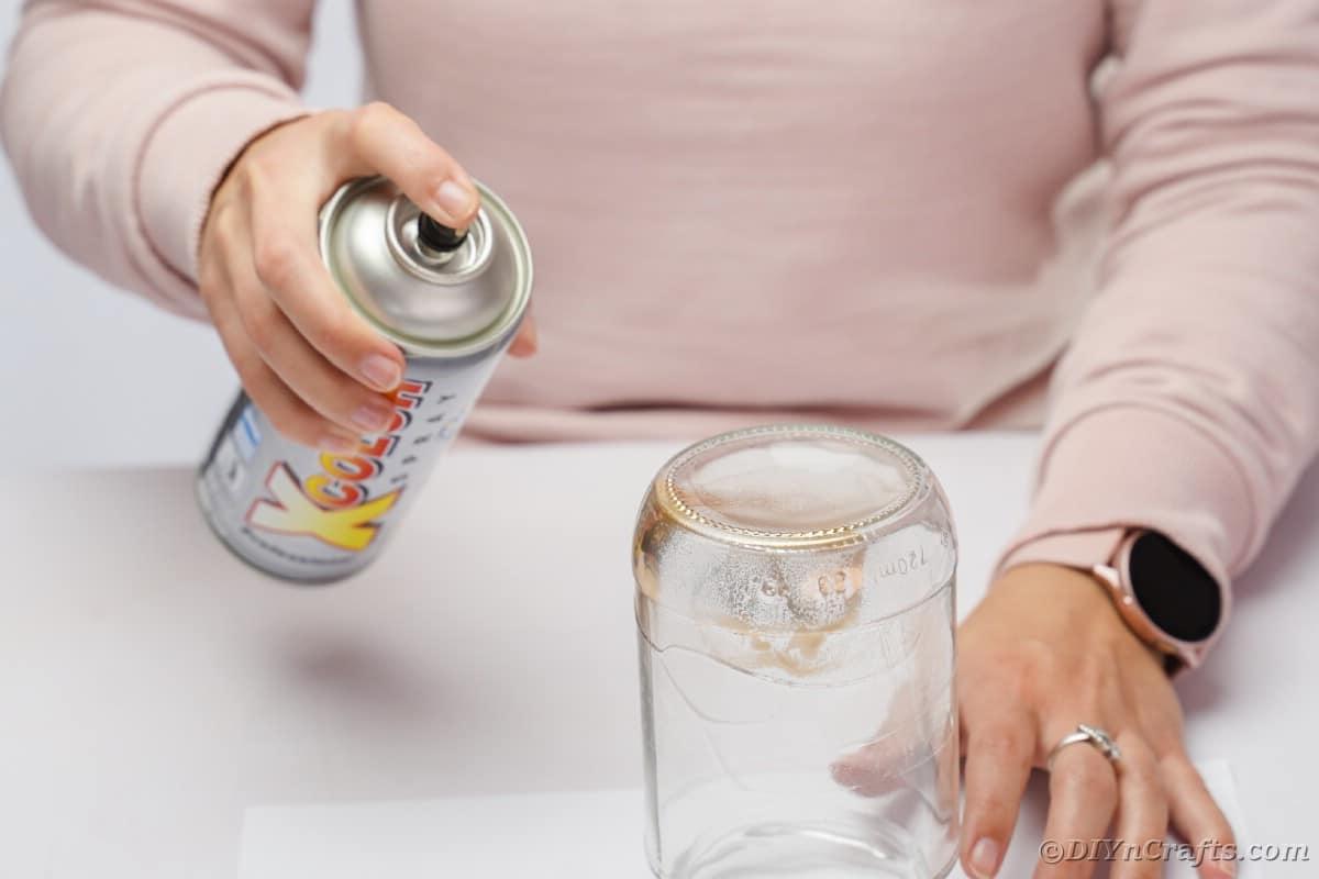 Spraying mason jar bottom gold