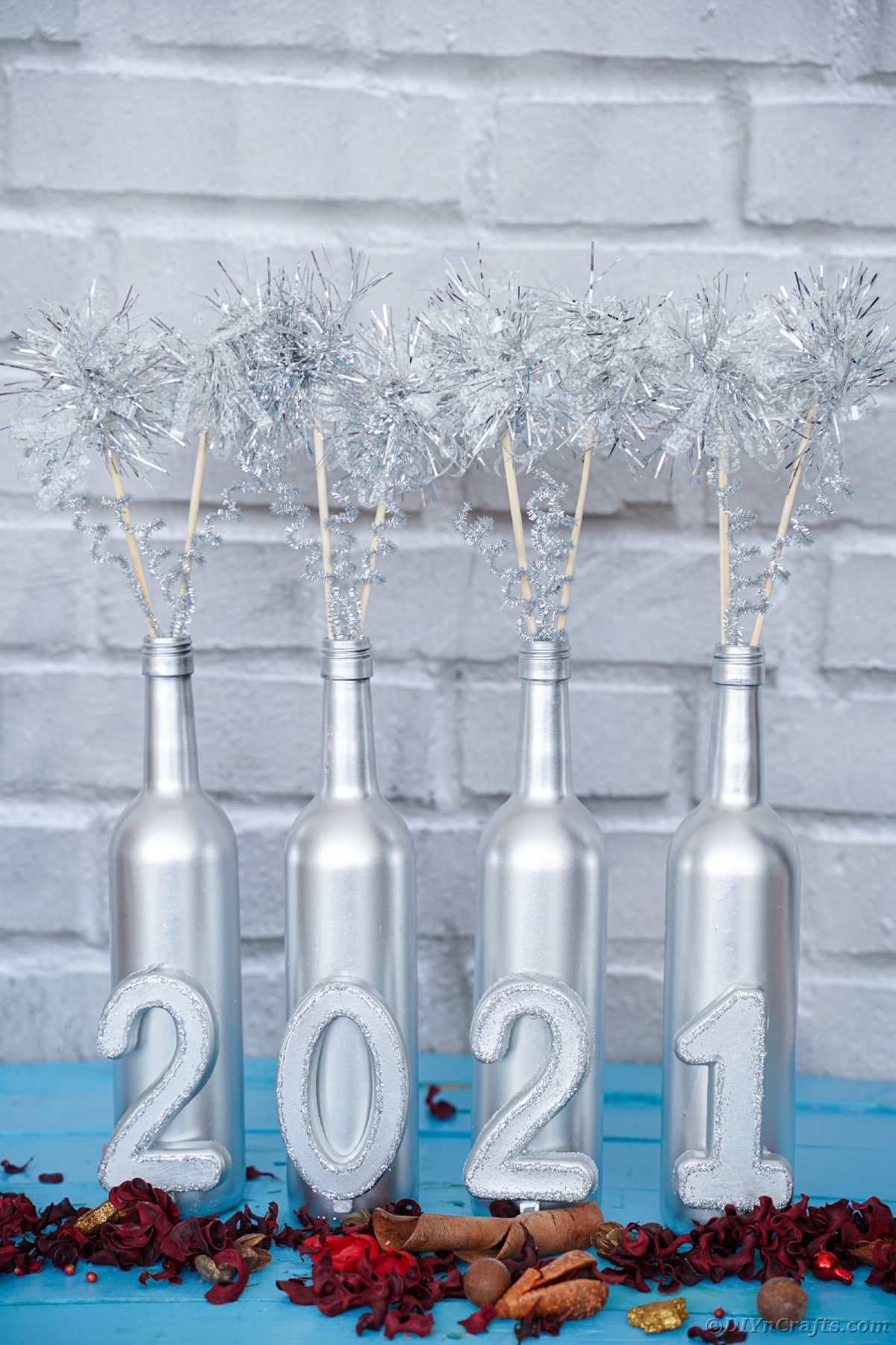 Silver wine bottle decoration by white brick