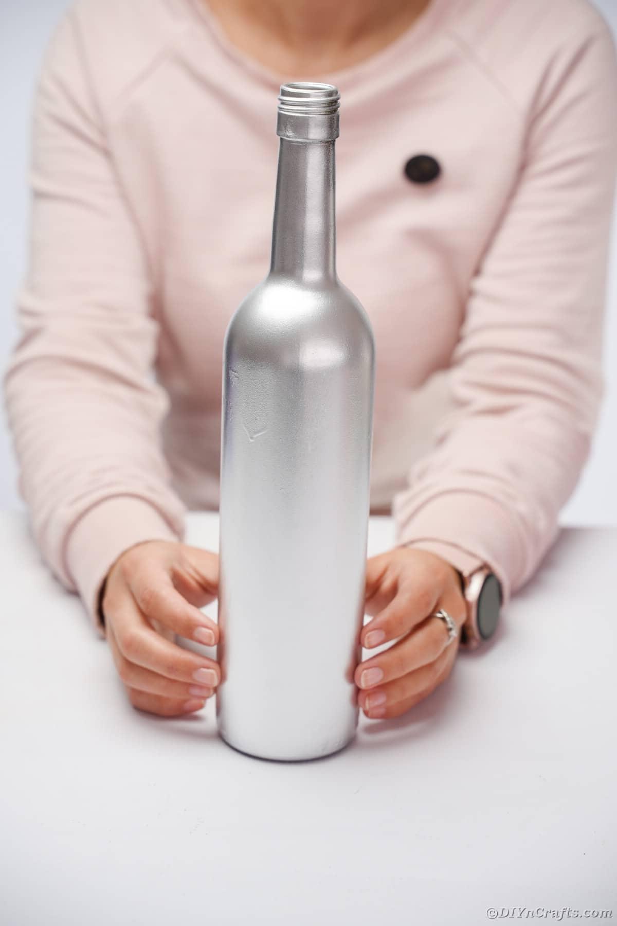 Spraying wine bottle silver