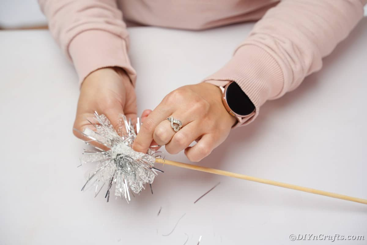 Attaching tinsel to dowel
