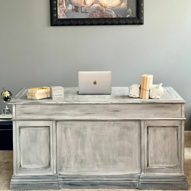 Distressed desk by wall