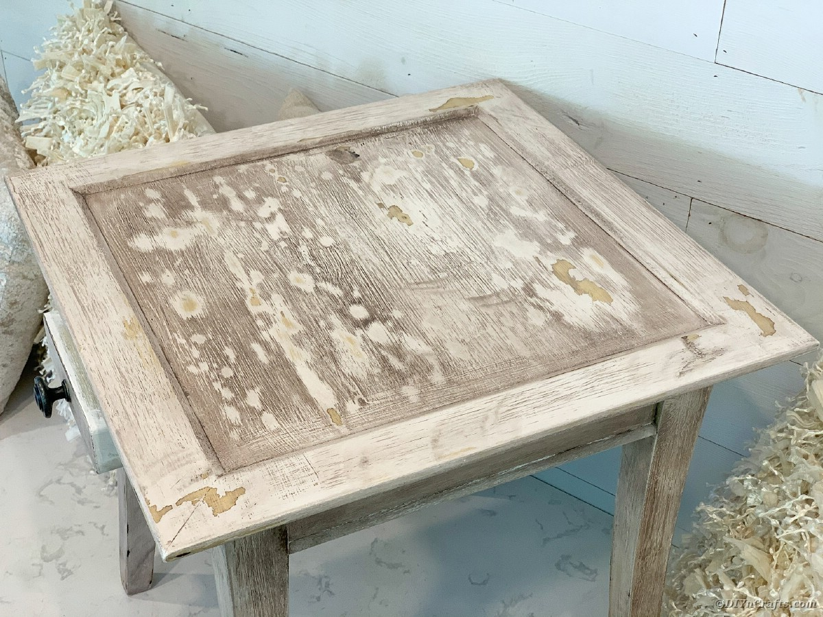 Top of distressed end table