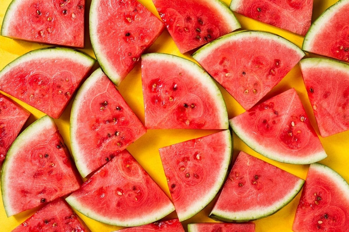 delicious sliced watermelon in a yellow background