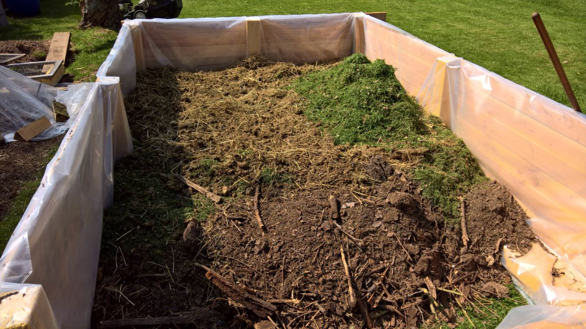 raised bed with grass, compost and branches