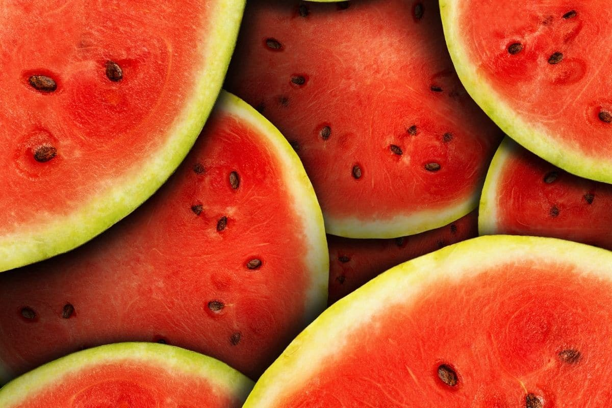 close up photo or watermelon with black seeds