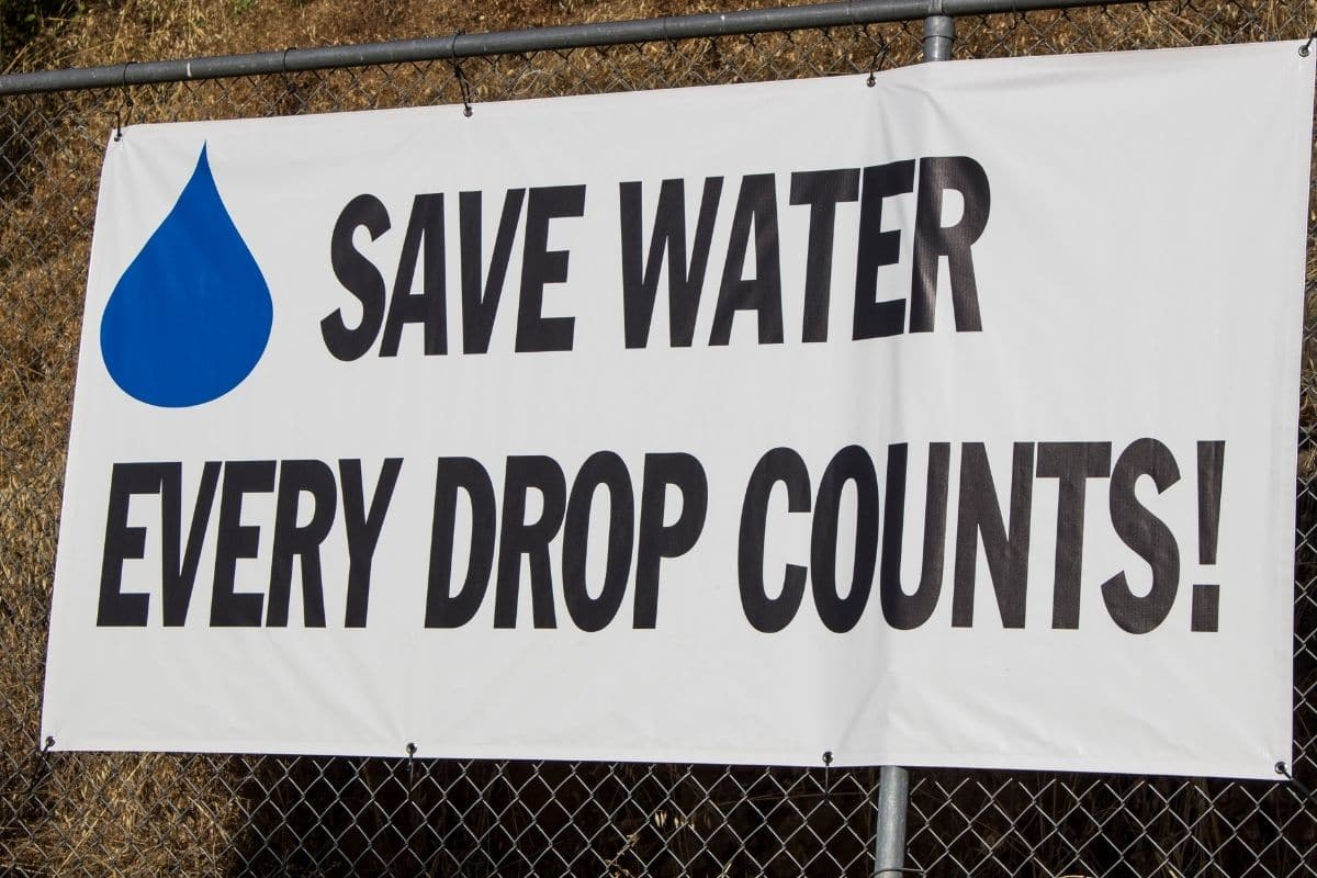 save water sign in a fence