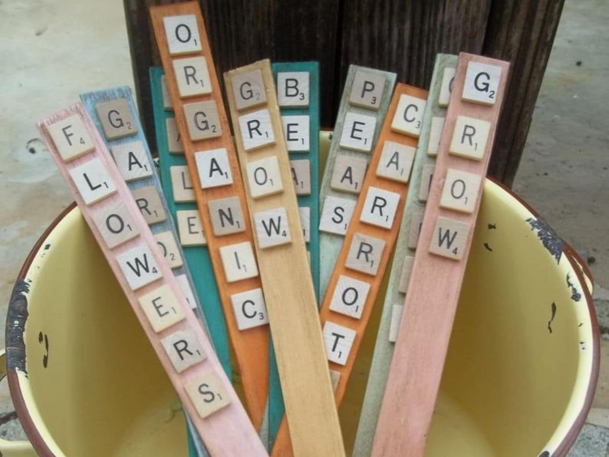 Yellow bucket with scrabble tile plant markers