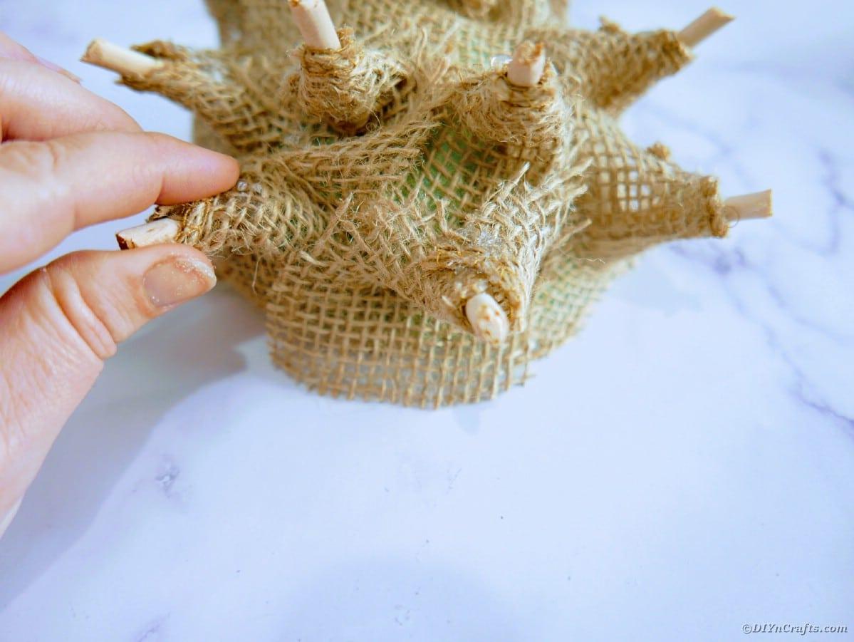 Burlap hedgehog being assembled