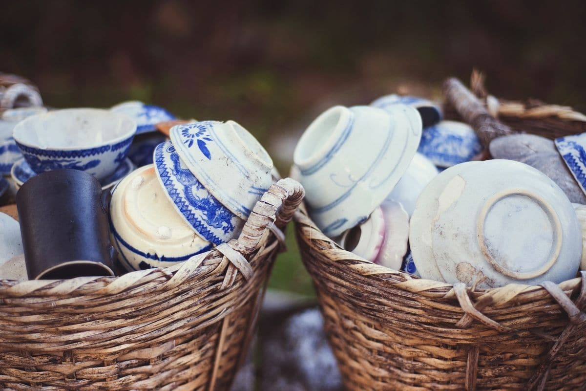 old stock of dish and pots kept in a basket