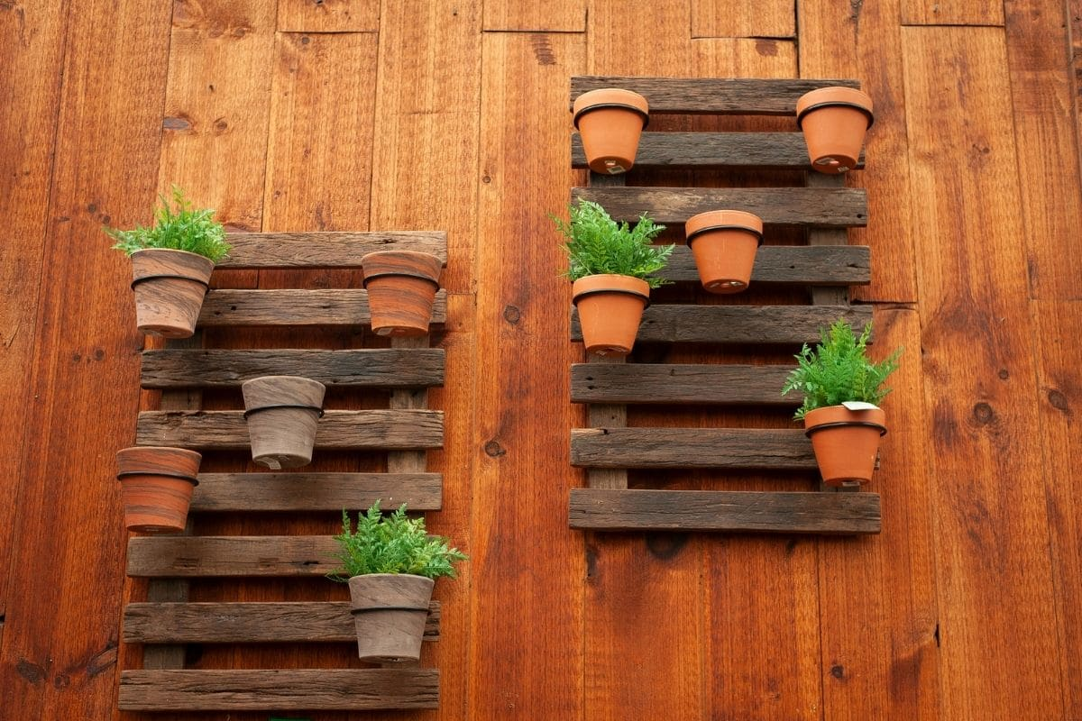 pallets in a wall with pots