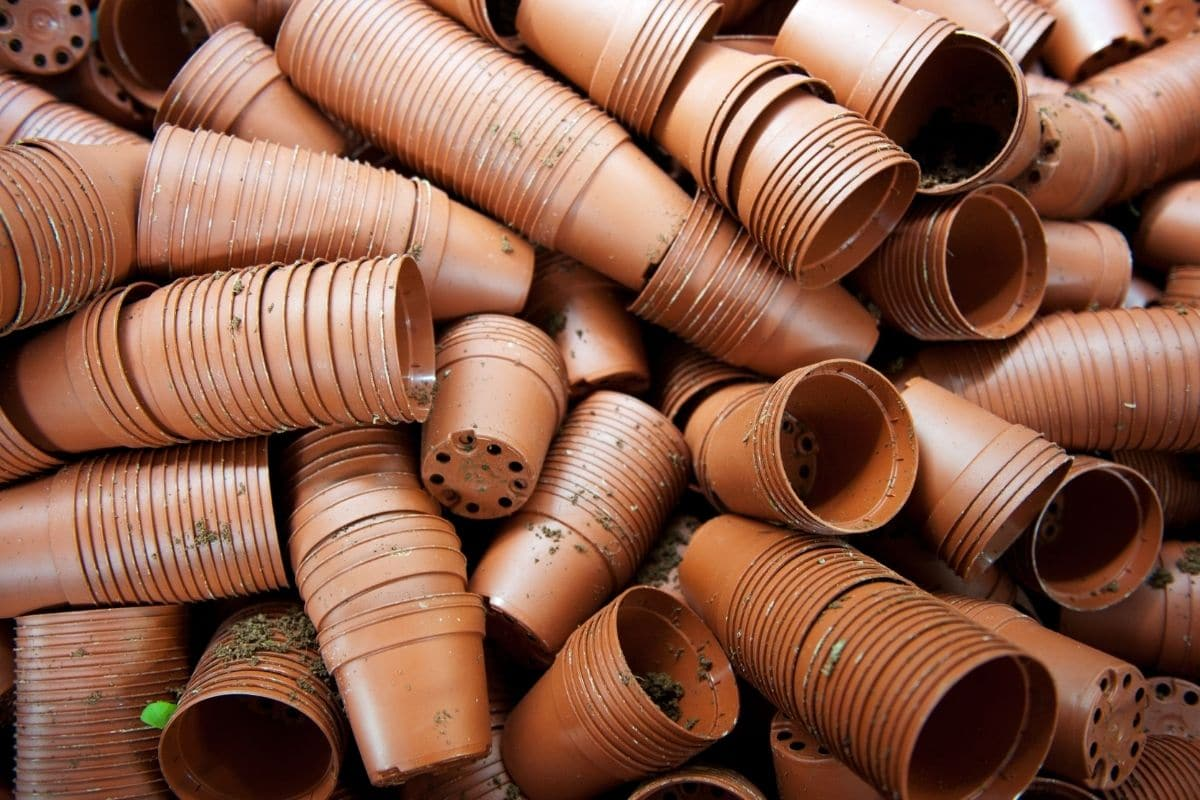 used and stock of dirty pots with multiple drainage