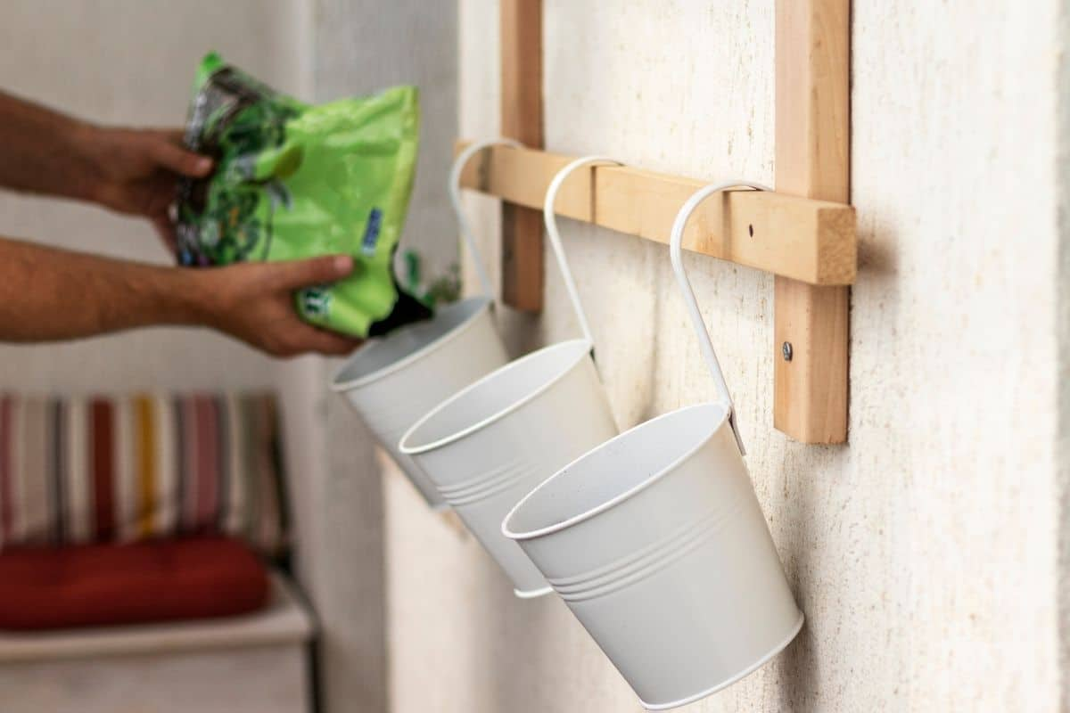 filling the hanging bucket in the shelf against a wall