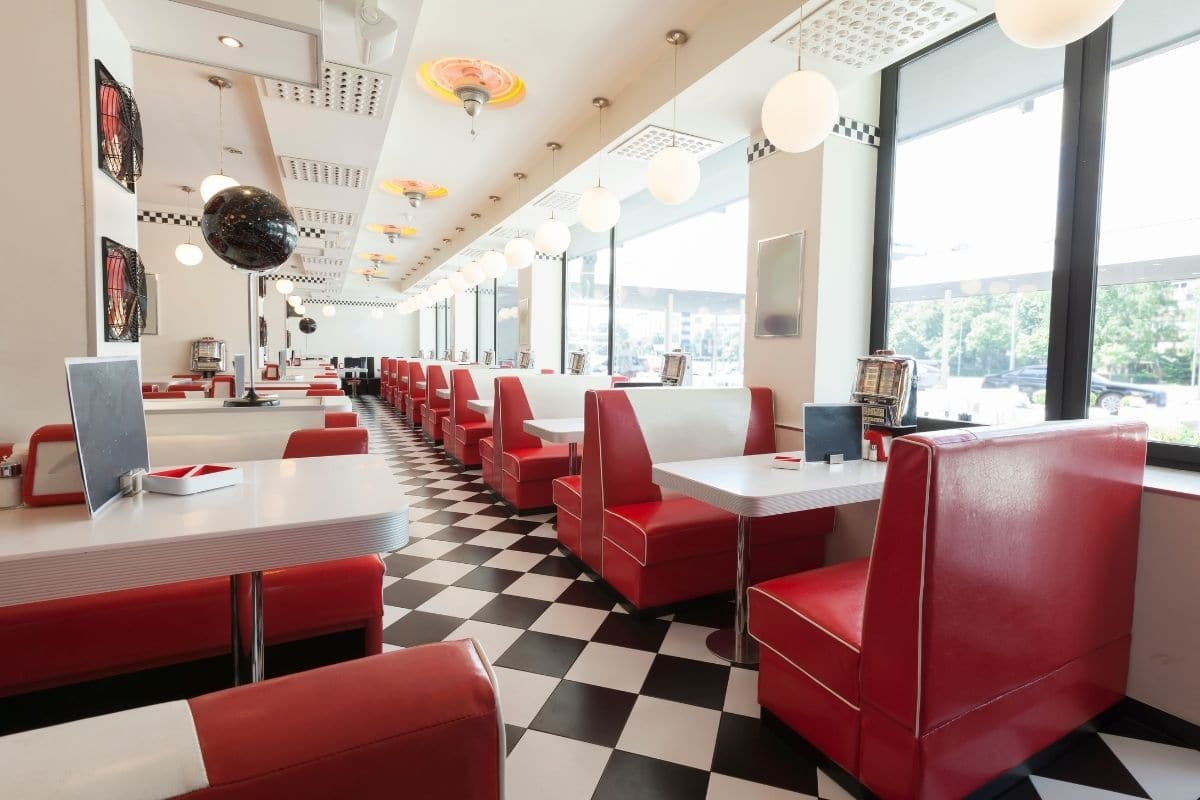 inside of a restaurant with red and white interior colors
