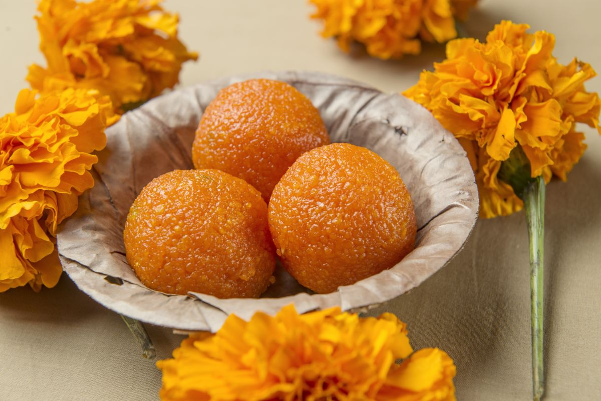 food in a bowl with marigold flowers around