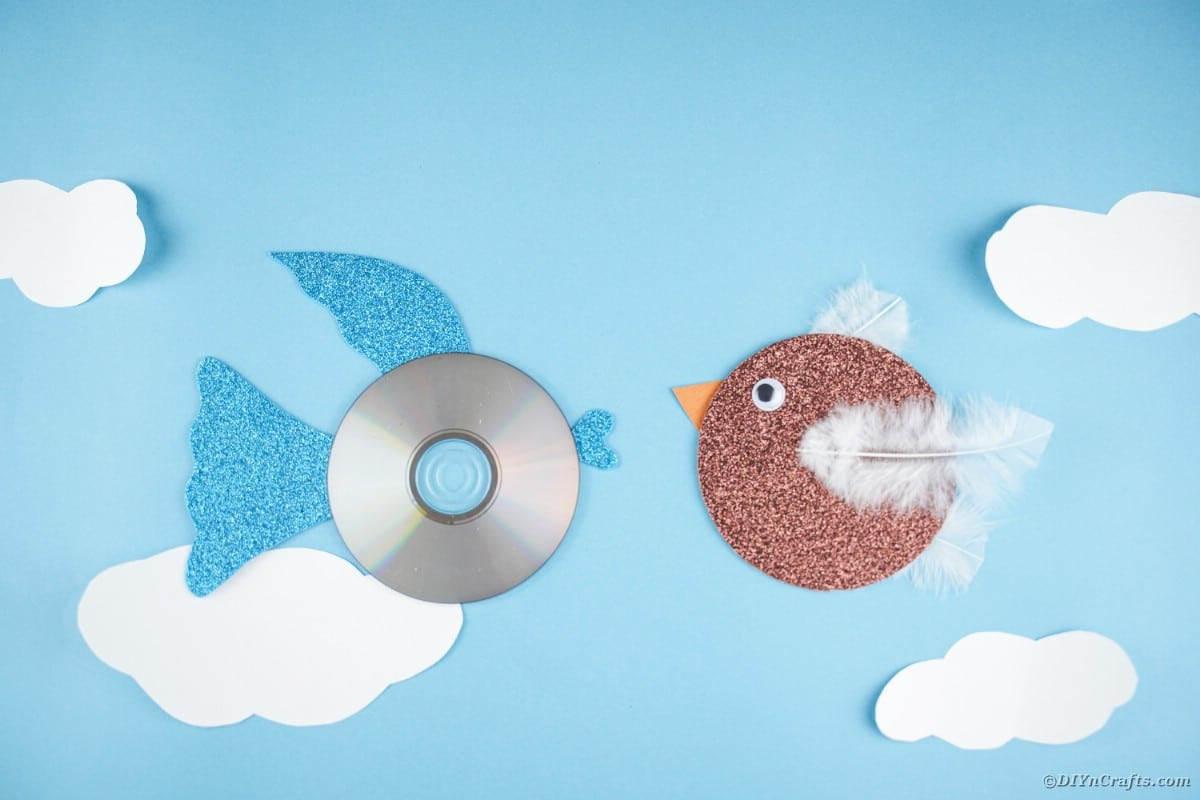 CD fish and bird on blue paper