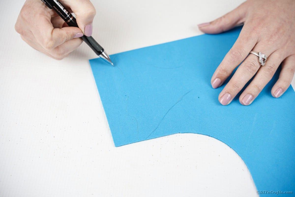 Tracing on blue foam paper