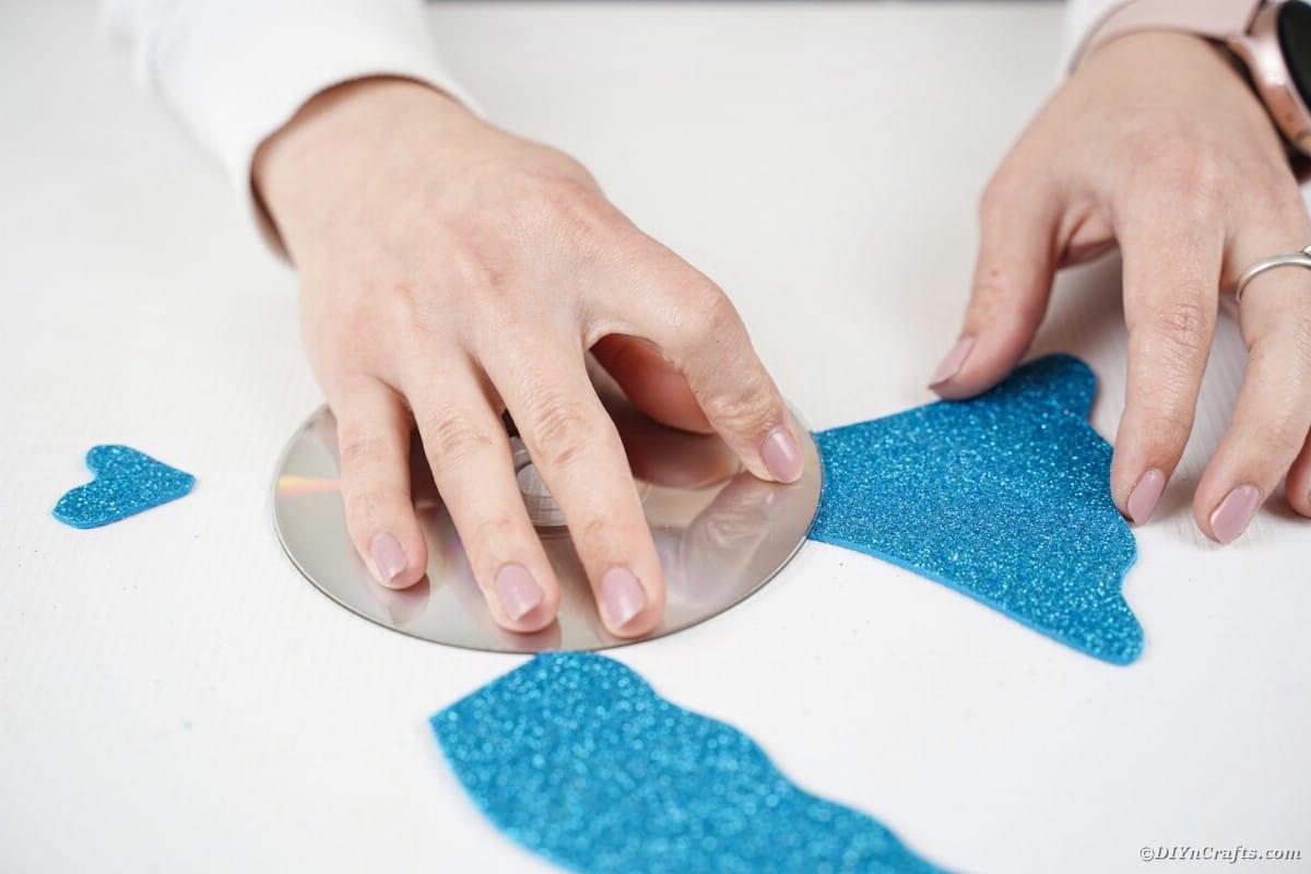 Gluing foam paper fins onto cd