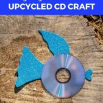 CD fish with blue fins on wood slice