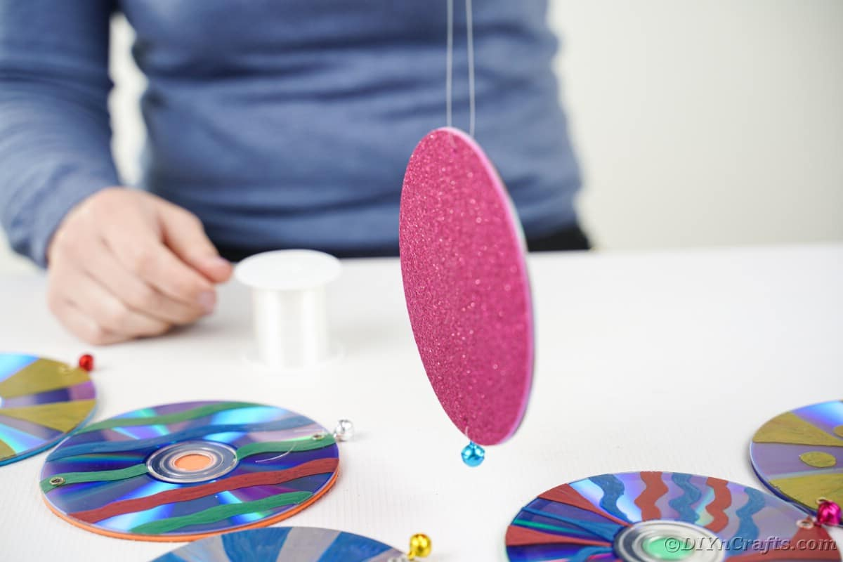 Stringing a fishing line through CD
