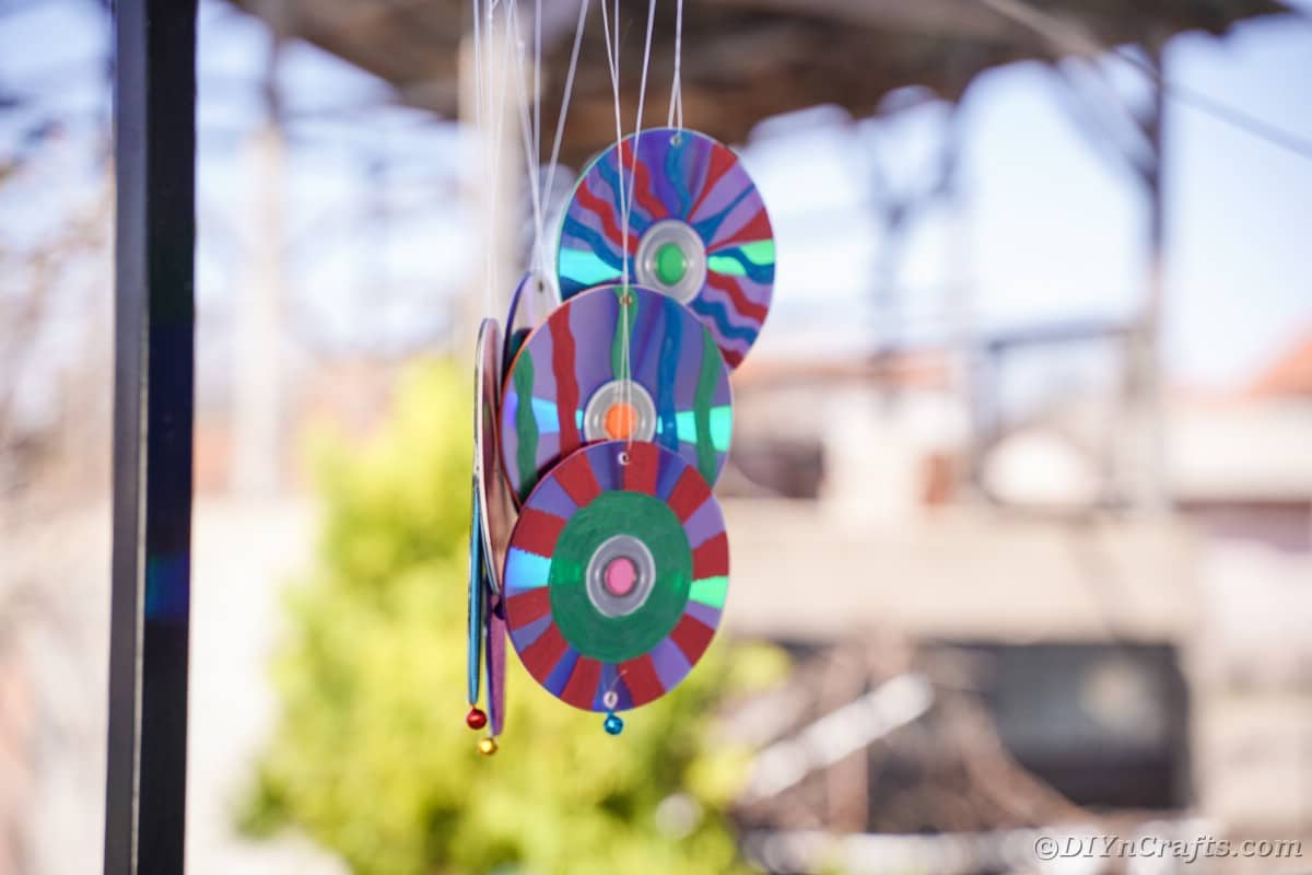 Colorful CDs on the bottom of a wind chime