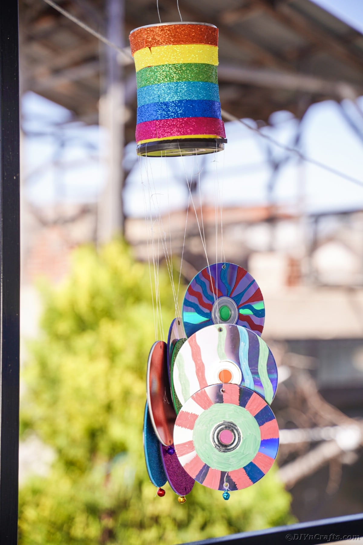 Rainbow wind chime by gutter